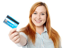 Young lady showing her cash card Stock Photography