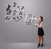 Young lady singing and listening to music Royalty Free Stock Image