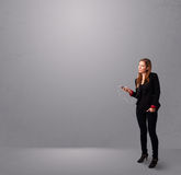 Young lady singing and listening to music with copy space Royalty Free Stock Photography