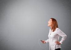 Young lady singing and listening to music with copy space Stock Photos