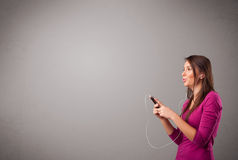 Young lady singing and listening to music with copy space Stock Photography