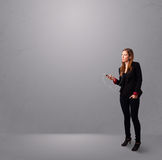Young lady singing and listening to music Royalty Free Stock Images