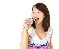 Young Lady Singing Into Microphone Stock Photography