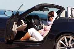 Young lady sitting in cabriolet Stock Photography