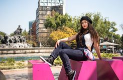 Young lady sitting  on the CDMX sculpture in la Condesa. Young lady sitting on the CDMX sculpture in la Condesa stock photography