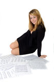 Young lady sitting with piano scores. On white background royalty free stock photos