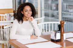 Young lady sitting at the restaurant Royalty Free Stock Photography