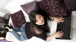 Young lady sitting on sofa Royalty Free Stock Photo