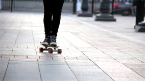 Young lady on the skateboard stock video footage