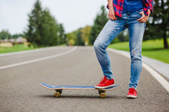 Young lady with skateboard Royalty Free Stock Photography