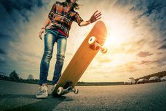 Young lady with skateboard stock photo
