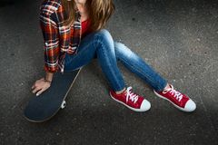 Young lady with skateboard Royalty Free Stock Image
