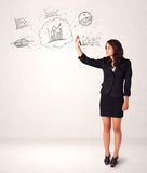 Young lady sketching financial chart icons and symbols Royalty Free Stock Photo
