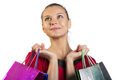 Young lady with smile handing bags. Closed up Royalty Free Stock Image