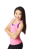 Young Lady Smiling. Half body portrait of asian american girl smiling in studio on white background wearing casual athletic clothing (pink Stock Images