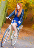 Young lady is smiling and riding the bike. Stock Images