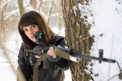 Young lady with a sniper rifle. Portrait of gorgeous young lady with a sniper rifle Royalty Free Stock Photo