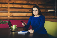 Young lady speak on phone at work. Young business lady call on phone in office hub Stock Images