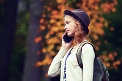 The young lady speaks in the smartphone. Stock Image