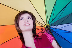 Young lady standing with color umbrella Royalty Free Stock Photography