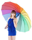 Young lady standing with color umbrella Royalty Free Stock Image