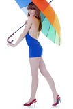 Young lady standing with color umbrella Stock Photography
