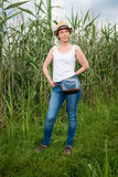 Young lady standing by the field Stock Images