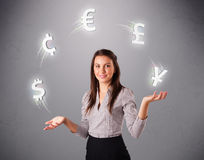 Young lady standing and juggling with currency icons Stock Photo