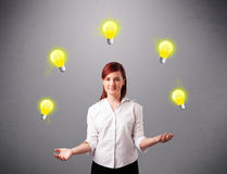 Young lady standing and juggling with light bulbs Royalty Free Stock Images