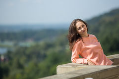 Young lady standing at the parapet. Stock Photo