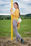 Young lady standing by the pole Royalty Free Stock Photography