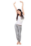 Young lady stretching after awaking Stock Photos