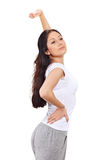 Young lady stretching after awaking. Young beautiful brunette lady stretching after awaking royalty free stock image