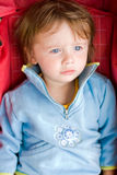 Young lady in the stroller. Royalty Free Stock Photography