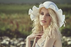 Young lady with sun hat Stock Photo