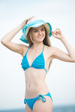 Young lady sunbathing on a beach. Beautiful woman posing at the Royalty Free Stock Image