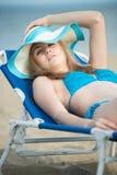 Young lady sunbathing on a beach. Beautiful woman Royalty Free Stock Photo