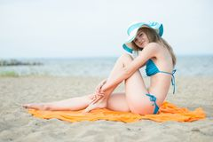 Young lady sunbathing on a beach. Beautiful woman Stock Photography