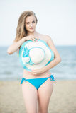Young lady sunbathing on a beach. Beautiful woman posing at the Royalty Free Stock Photography