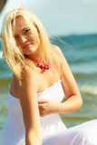 Young lady on sunny beach. Stock Photos