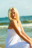 Young lady on sunny beach. Royalty Free Stock Photos