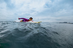 Young lady surfer Royalty Free Stock Photography
