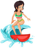A young lady surfing Stock Images
