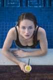 Young lady in a swimming pool stock photo