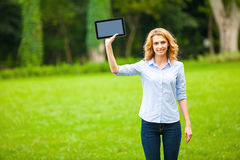 Young lady with tablet in park Stock Photos