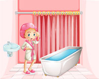 A young lady taking a bath in the bathroom Royalty Free Stock Photos