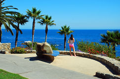 Young lady taking in ocean view at Heisler Park, Laguna Beach, CA Stock Photos
