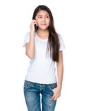 Young lady talk to cellphone Royalty Free Stock Photo