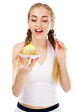 Young lady tasting a cake Royalty Free Stock Image