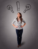 Young lady thinking with question marks overhead Royalty Free Stock Image